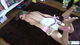 Chloe hogtied in a thick diaper