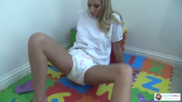 Danielle has wet her diaper playing on the abc mats